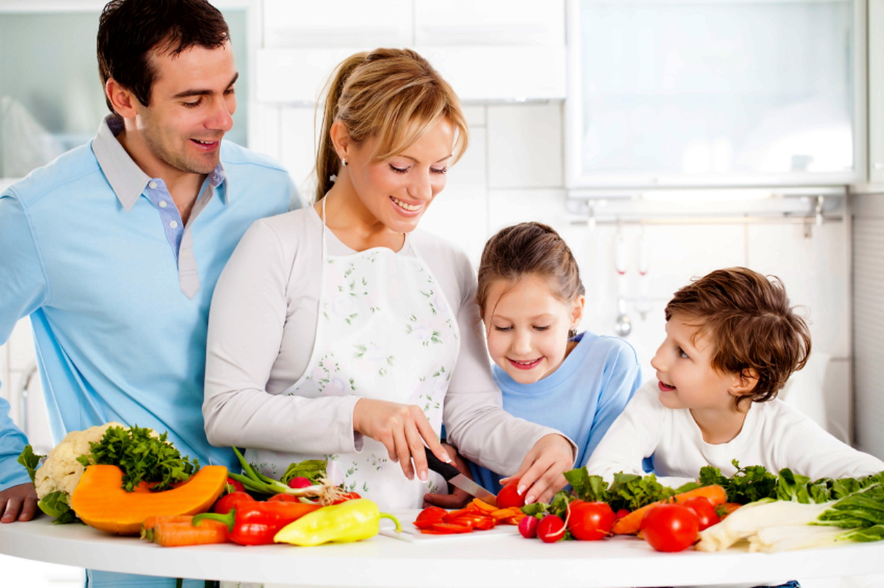 Happy family preparing a healthy dinner at home