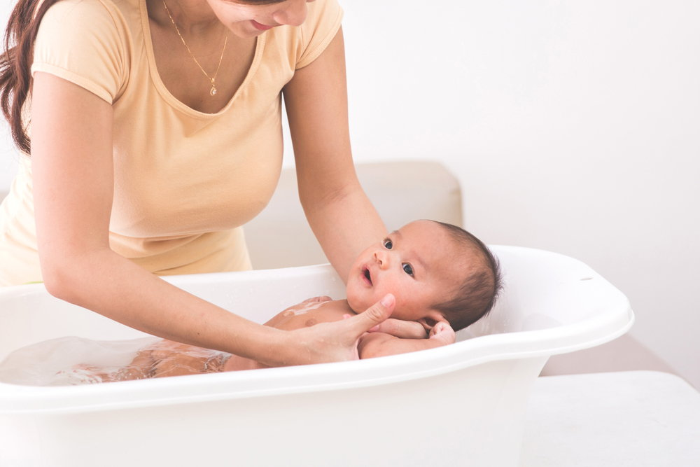 Baby bathing in a tub