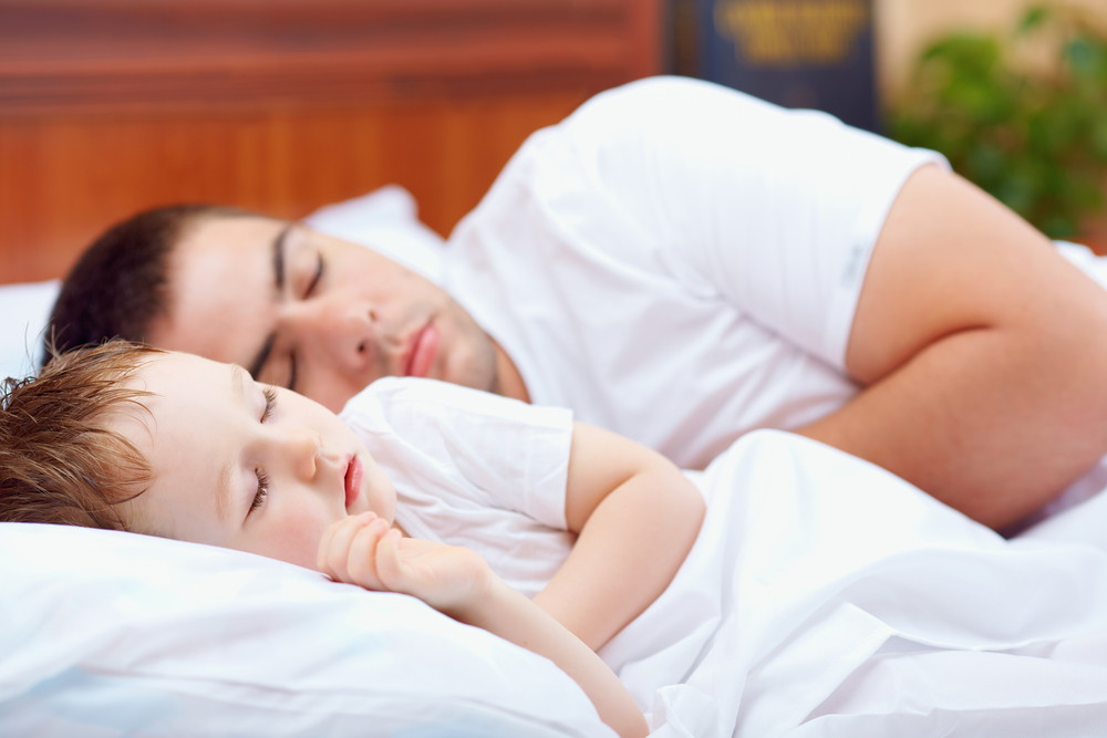 Father and son taking sound sleep
