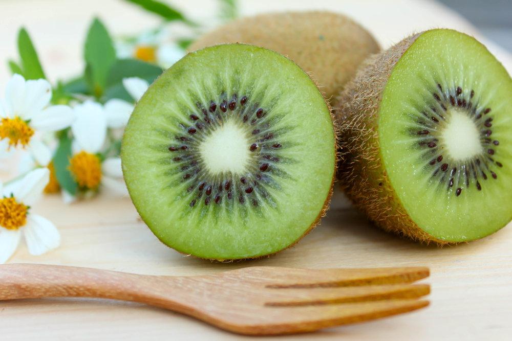 Kiwi fruits on branches